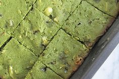 Fresh Green Tea Brownies 1 stick unsalted butter, 1½ cup white chocolate chips, 2 eggs, 1 C. flour, ¼ C. matcha green tea powder, ½ tsp almond extract, ¼ tsp vanilla extract, ½ cup almond slices, 1. Melt butter & 1 C. white chocolate chips. Let Cool. 2. add eggs & matcha powder. 3. Add flour, almond, & vanilla. 4. Fold in almonds & remaining chips. Pour batter into Greased/floured 8x8 Bake @ 350 F 20-25 min. Cool, cut.
