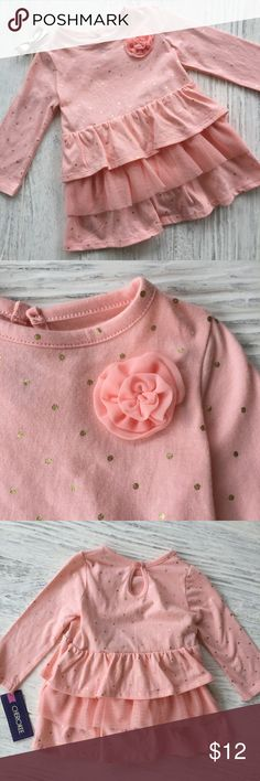 Cherokee Daydream Pink Dress Pretty in pink! Beautiful long sleeve tiered ruffle dress with pretty flower detail. Daydream pink (almost a peachy pale pink) with gold dots. Comes with matching diaper cover. Cherokee 6-9M Brand New With Tags. Absolutely adorable! Cherokee Dresses