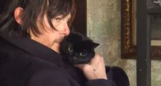 "Norman Reedus poses with his sweet black cat, ""Eye in the Dark"": sexy and cute?"