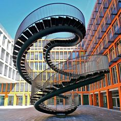 permanently installed in the atrium of an office building in #munich 'umschreibung' by olafur eliasson comprises two spiral staircases that interlock with each other creating a continuous loop in the form of a double helix. @studioolafureliasson  by philipp klinger  see more on #art and #architecture on #designboom. #olafureliasson #staircases by designboom