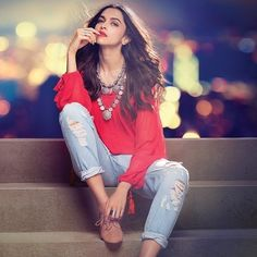 Make a style statement in ripped denims like Deepika Padukone! Shop her look now! #BollywoodFashion #CelebrityStyle #BollywoodActress #WomensFashion