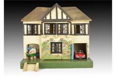 A Tri-ang dolls' house DH/61 1930s, with painted thatched roof, cream walls, painted timbers and