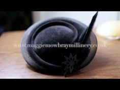 Making Millinery - Behind the Scenes. Watch Maggie Mowbray create a sculpted freeform felt hat with feathers and leather flower from her Winter 2016 collection.