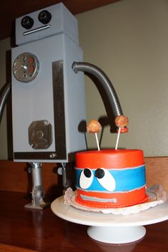 Little-bot guards the Smash Cake until it's time for Easton to have at it. - Robot Birthday Party #robot #robotparty #smashcake #Albertsons #robotcake