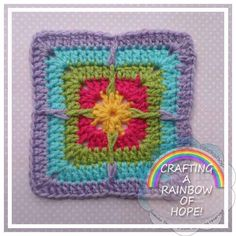 Designed exclusively for the American Crochet – Crafting A Rainbow Of Hope Basic Material Requirements: Double knitting / light worsted (No 3) yarn –small amounts of yarn in 5 colors (yellow, dark pink, green, aqua and purple) Hook 4,00 mm Yarn needle Size:5 x 5 inch (12, 7 cm) Skill Level: Easy Notes: Tension/Gauge is not necessary for this project to be perfect I use US Crochet stitch terminology Abbreviations: CH – chain SL ST – slip stitch SC – single crochet DC – double c...