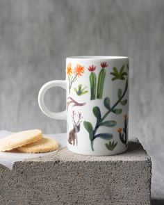 Retreat Tall Mug - A tall mug is a surefire conversation starter. Lively cats bound through the underbrush amongst budding blooms, flourishing vines and other fantastical foliage. Surefire, Conversation, Kitchen Dining, Vines, The Secret, Mugs, Tableware, Garden, Kitchens