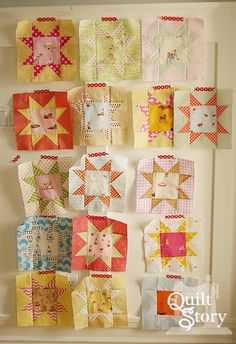 Love the idea of featuring a fabric within a star.  Heather Ross star quilt blocks.... - Quiltstory