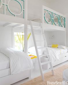 Sally Markham designed a lattice railing for these girls' bunk beds in Sullivan's Island, South Carolina. The touch of Benjamin Moore's Peacock Blue on just the inside of the cut-outs is a genius exercise in restraint. Pin it »   - HouseBeautiful.com