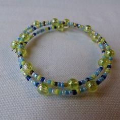 Bracelet à mémoire de forme bicolore  tons bleus et jaunes