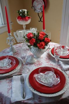 Flowered sheet for a tablecloth, red and white for Valentine's Day.