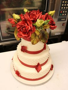 wedding cake @Randa Larson Hinthorne - love this small cake, not digging the HUGE flowers on top though. lol