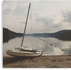 When you visit Schroon Lake in the Adirondack Mountains of Upstate New York you mostly see motorboats, pontoon boats, kayaks and jetski. Every once and awhile you will see a sailboat. There is something to be said about enjoying travel and local scenery without the noise of of artificial power, but rather harnessing nature to navigate your journey and get you to your destination. This canvas print makes a great gift for the sailors in your life as part of their nautical theme home decor.