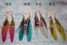 cute feather earrings w/ beads, coil findings, and leather strands.