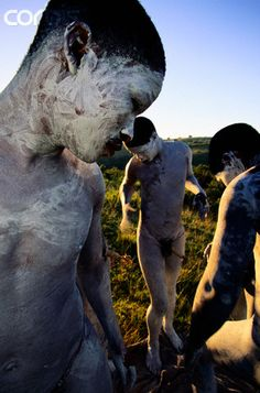 Africa | Xhosa initiates near Qora Mouth in South Africa cover their bodies with white clay.| ©Roger de La Harpe