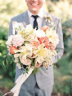 Wedding Bouquet - with more flowers than we can name! So beautiful!! See the wedding on Style Me Pretty: http://www.StyleMePretty.com/2014/02/26/elegant-del-mar-garden-wedding/ Photography: Ashley Kelemen