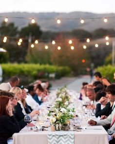 Bistro lights lit these alfresco reception tables as the sun set during dinner.