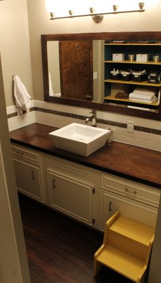 Used old vanity but put a new Wooden Bathroom Vanity Top and vessel sink