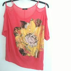 """Deb 2X Coral Cold Shoulder Flower Top This Deb 2X Coral Cold Shoulder Flower Top is in good used condition. Super soft and stretchy knit (rayon / spandex) with metallic accents on the flower. 29"""" long. Bust measures 28"""" across laying flat, so 56"""" around unstretched. ::: Bundle 3 + items from my closet and save 30 % off when you use the app's Bundle feature! ::: No trades. Deb Tops"""