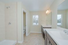 Owners Bath: dual vanity with make-up counter, marbelite counters, ceramic tile floors, walk-in shower, natural light.