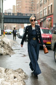 Cute jumper cinched at the waist with a thick belt and a jacket with tassels. Her bag is awesome too!Love this look