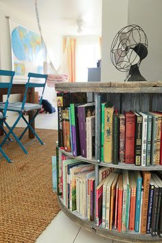 This homeowner salvaged an old wooden electrical spool left over from her home's construction. She now uses it as a shelf for textbooks. Beautiful reclaimed project.