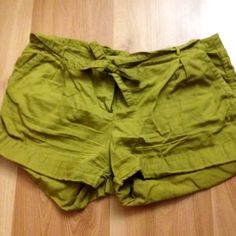 """Jcrew Cotton Green Shorts Avocado green bloomer 3"""" shorts with cuffs at the hem, front and back pockets, front zipper and snap closure, and matching tie. These are """"city fit"""" and ate cut to be roomier. The first photo is very true to color, the others make these look like a lighter green than they actually are. J. Crew Shorts Skorts"""