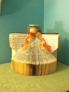 Beautiful angel made from an old hymn book.