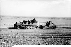 German Army SdKfz. 7 half-track vehicle towing a 8.8 cm FlaK gun in North Africa April 1941. Credit: Bundesarchiv Bild 101I-783-0109-19 Dörner.