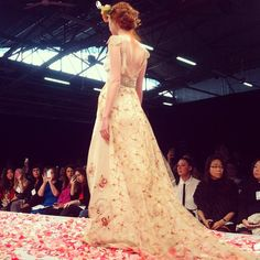 Beautiful colored embroidery on train @clairepettibone #bridalmarket #instagram