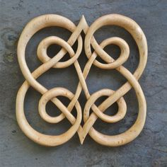This complex infinity knot reflects the twists and turns that two people experience while on life's journey. It is 5 x 5.5 inches and is carved on both sides. It is made of white birch and finished with tung oil. Viking Tattoo Symbols, Celtic Symbols, Viking Tattoos, Celtic Art, Celtic Tattoos, Irish Symbols, Celtic Crosses, Love Symbols, Wooden Crosses