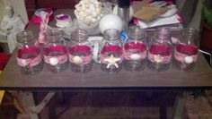 Mason jars with pink & lace wrapped around to hold bridesmaid bouquets at reception...