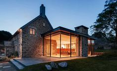 Wide Glass Wall With Fantastic Lamps Decoration As One Of The Modern Extension To The Old Stone House Along With Stone Terrace And Green Court The Modern Extension to the Old Stone House Modern Farmhouse Exterior, Rustic Farmhouse, Farmhouse Style, Urban Farmhouse, Farmhouse Plans, Cottage Extension, Oak Frame House, Old Stone Houses, Glass Extension