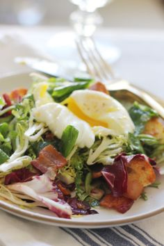 frisee and lardon salad with a poached egg