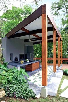 Start here if you're building a roof over a patio or deck. This article discusses strategies for building over an existing slab patio or over a deck, . Backyard Projects, Backyard Patio, Backyard Landscaping, Patio Roof, Outdoor Kitchen Bars, Outdoor Kitchen Design, Outdoor Spaces, Outdoor Living, Alfresco Area