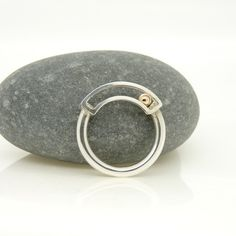 'Rolling' Kinetic Ring in Sterling Silver with 9ct Gold £155.00 by Claire Wood Jewellery