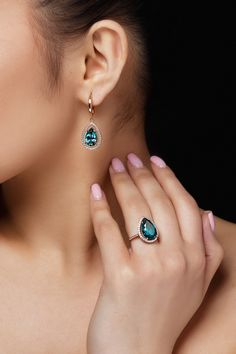 Model shows earrings and ring with beautiful blue precious stones Free Photo Diamond Hoop Earrings, Ring Earrings, Top Gifts, Crystals And Gemstones, Designer Earrings, Beautiful Earrings, Crystal Jewelry, Jewelry Collection, Gifts For Her