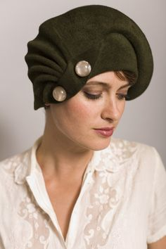 Olive green, felt, draped by hand cloche hat. The details on this hat are vintage buttons.cloche by 'yellowfield7' on Etsy.