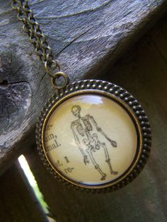 Skeleton Halloween Necklace--Day of the Dead--Dia de los Muertos--Vintage Dictionary Print Handmade Jewelry--Biology Orthopedic Gift by ChloesWindow on Etsy