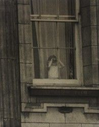 June 2, 1953...Prince Charles looking out of a Buckingham Palace window on Coronation Day.