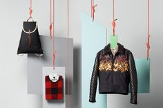 I don't necessarily like this collection on a whole (colors of the hanging geometric backgrounds could compliment the merchandise better, I think), but I do like the overall concept of this display.