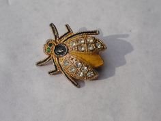 Bug Pin, Black and Gold, Insect jewelry, vintage bug brooch. $18.50, via Etsy.