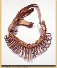 """According to Norman Feder,   """"...grizzly claw necklaces were apparently never vary numerous within any one tribe because of the difficulty in obtaining the claws.""""  (Feder & Chandler, 1961, p. 7)"""