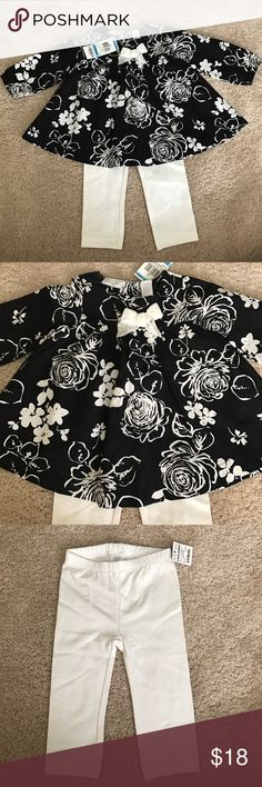 Baby Girl First Impressions Outfit Adorable baby girl outfit, First Impressions brand.  Black flared shirt with white flowers (100% cotton) with matching white leggings (95% cotton and 5% spandex).  Shirt has a cute velour bow on the front, and two buttons on the back.  New with tags; my daughter outgrew it before she had a chance to wear it. First Impressions Matching Sets
