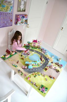 A girly girl handpainted Lego playtable?! Oh Lord!