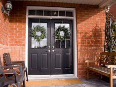Homedit brick with black front door- possible outside door color