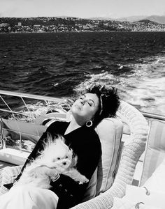 1993 - photo of Elizabeth Taylor with her beloved, sweet dog Sugar whom everyone adored and she took everywhere. Photographer Firooz Zahedi Talks About His 35-Year Friendship With Hollywood Icon Elizabeth Taylor.