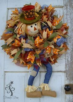 Great tutorial on burlap, mesh & ribbon wreath for fall - Trendy Tree DIY tutorial for wreath made with a scarecrow head, dangling legs, work wreath, frayed edge burlap and ribbons. Diy Fall Wreath, Wreath Crafts, Holiday Wreaths, Christmas Tree Decorations, Winter Wreaths, Spring Wreaths, Wreath Ideas, Summer Wreath, Diy Christmas