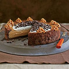 Cinderella Cheesecake: A chewy ring of brownie-batter crust folds over creamy and luscious peanut butter cheesecake to create an enchanting dessert. This decadent Halloween cake will have your guests trick or treating for more. Fall Cake Recipes, Dessert Recipes, Dessert Halloween, Halloween Treats, Halloween Party, Impressive Desserts, Fall Cakes, Fall Baking, Cheesecake Recipes
