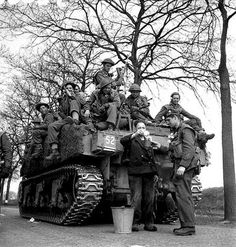 world_war_two - canadian_army - Riding on a Sherman Tank - Personnel of the Royal Hamilton Light Infantry aboard a Sherman tank of Canadian Soldiers, Canadian Army, Canadian History, British Army, Royal Canadian Navy, Hamilton, Historical Pictures, Ww2 Pictures, Ww2 Photos