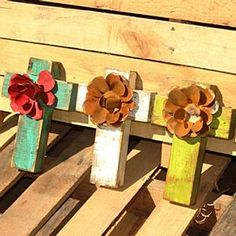 A Turquoise and a Red..? http://wrapsodyonline.com/store/product/65110/Wood-Cross-with-Metal-Flower-Small/